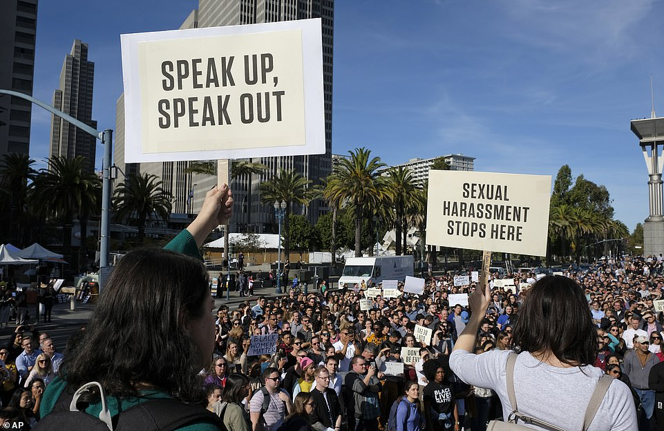 """Two Google employees meet a crowd of colleagues in San Francisco on Thursday with signs saying """"Speak, Talk"""" and """"Sexual harassment stops here"""" during a worldwide protest against allegations of sexual misconduct"""