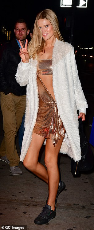 Gorgeous: Fellow model Toni Garrn was also seen flashing a peace sign as she head home from the star-studded soiree
