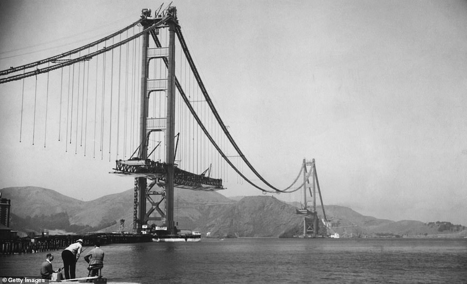 Golden Gate Bridge in San Francisco during its construction between 1933 and 1937. The bridge is 1.7 miles long, which connects San Francisco to the south with Marin County to the north