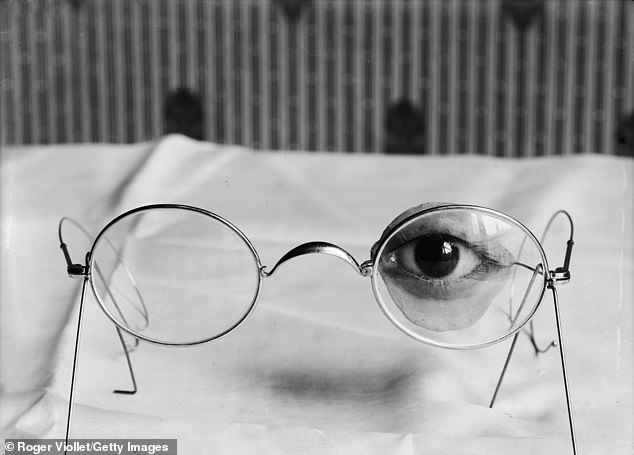 This is a close-up of an eye and eyelid prosthesis attached to glasses to fix it