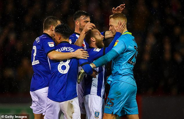 Dawson congratulates his Sheffield Wednesday teammates after saving the shot