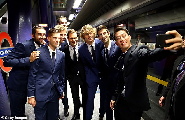 (Left to right) Marin Cilic, Dominic Thiem, Kevin Anderson, John Isner, Federer, Alexander Zverev, Djokovic and Kei Nishikori posed for pictured on the North Greenwich platform
