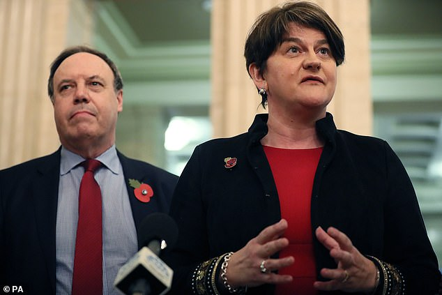 DUP leader Arlene Foster (right) and deputy leader Nigel Dodds speaking to the media in the Great Hall at Stormont, Belfast earlier this week. Foster said she does not want Northern Ireland treated differently to the rest of Britain