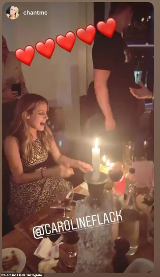 Candles: The star looked delighted as she was presented with cake after a pub dinner