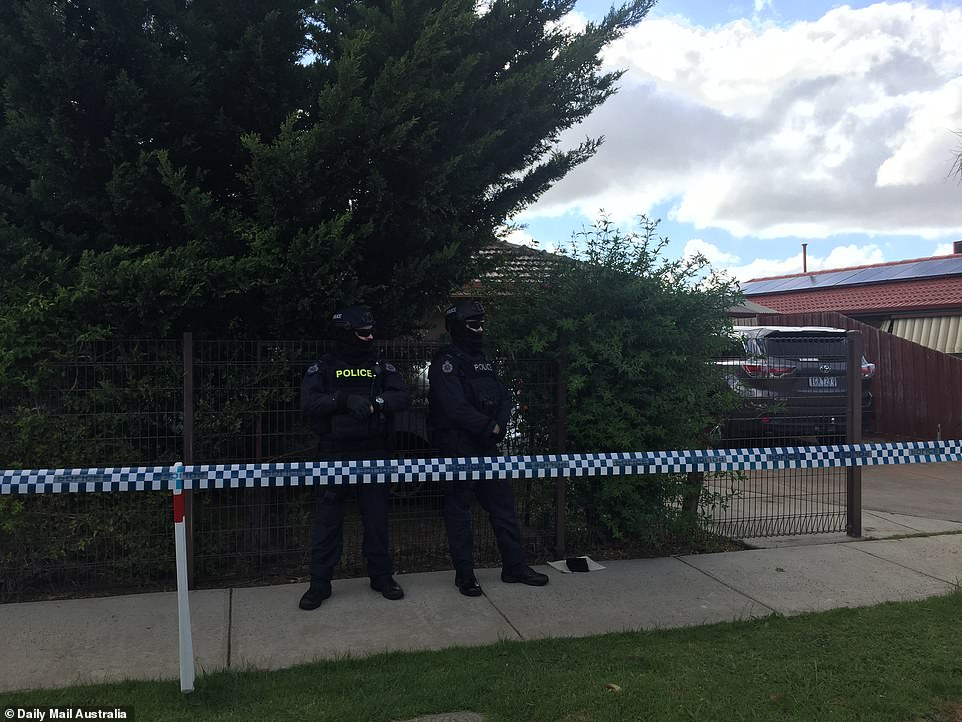 His family are inside the house and cooperating with authorities. Khalif's wife, who police also believe to be radicalised, was missing on Friday night but has since been interviewed by police