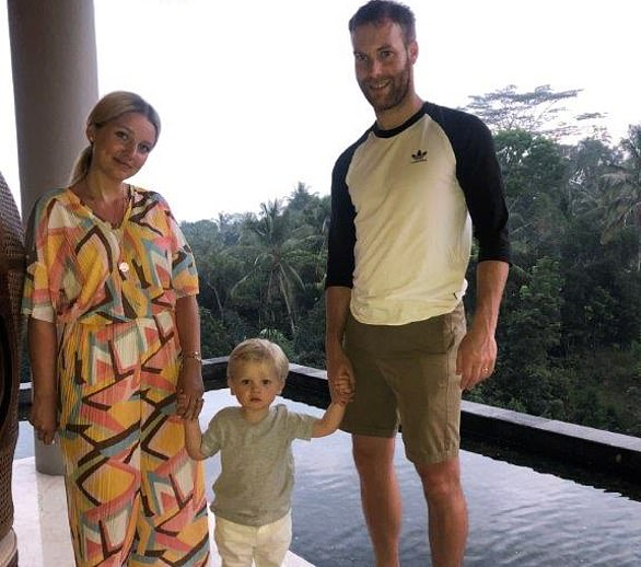 Georgia Dayton, with his two-year-old son, Axel, and her husband James