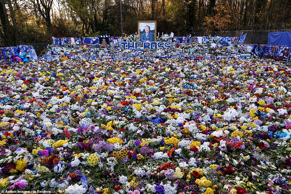 The parking lot where the tragic helicopter crash took place is a sea of flowers and homage to the Thai businessman