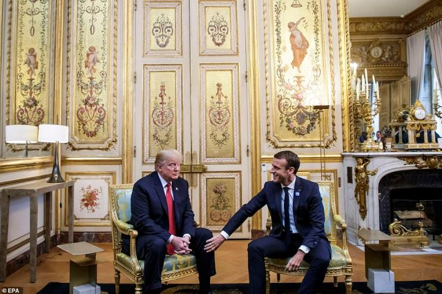 Emmanuel Macron briefly touches Donald Trump's knee during their meeting at the Elysee palace in Paris, France