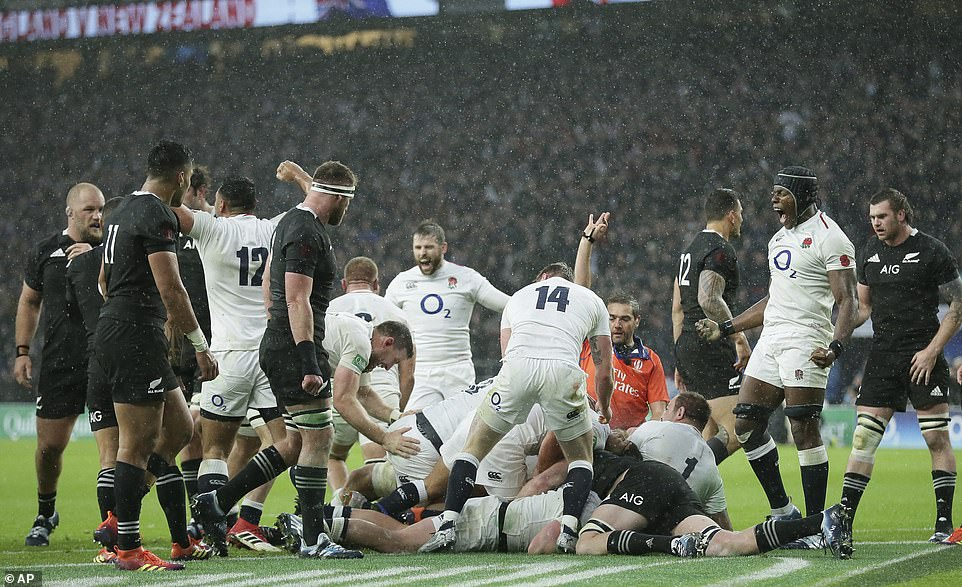 The English players celebrate after Dylan Hartley scored their second attempt at the international autumn clash against the All Blacks