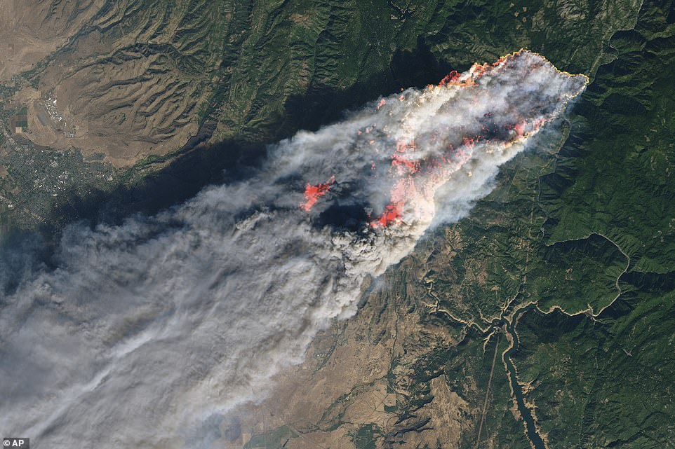 This enhanced satellite image provided by NASA's Earth Observatory, shows the Camp Fire at its peak on Thursday