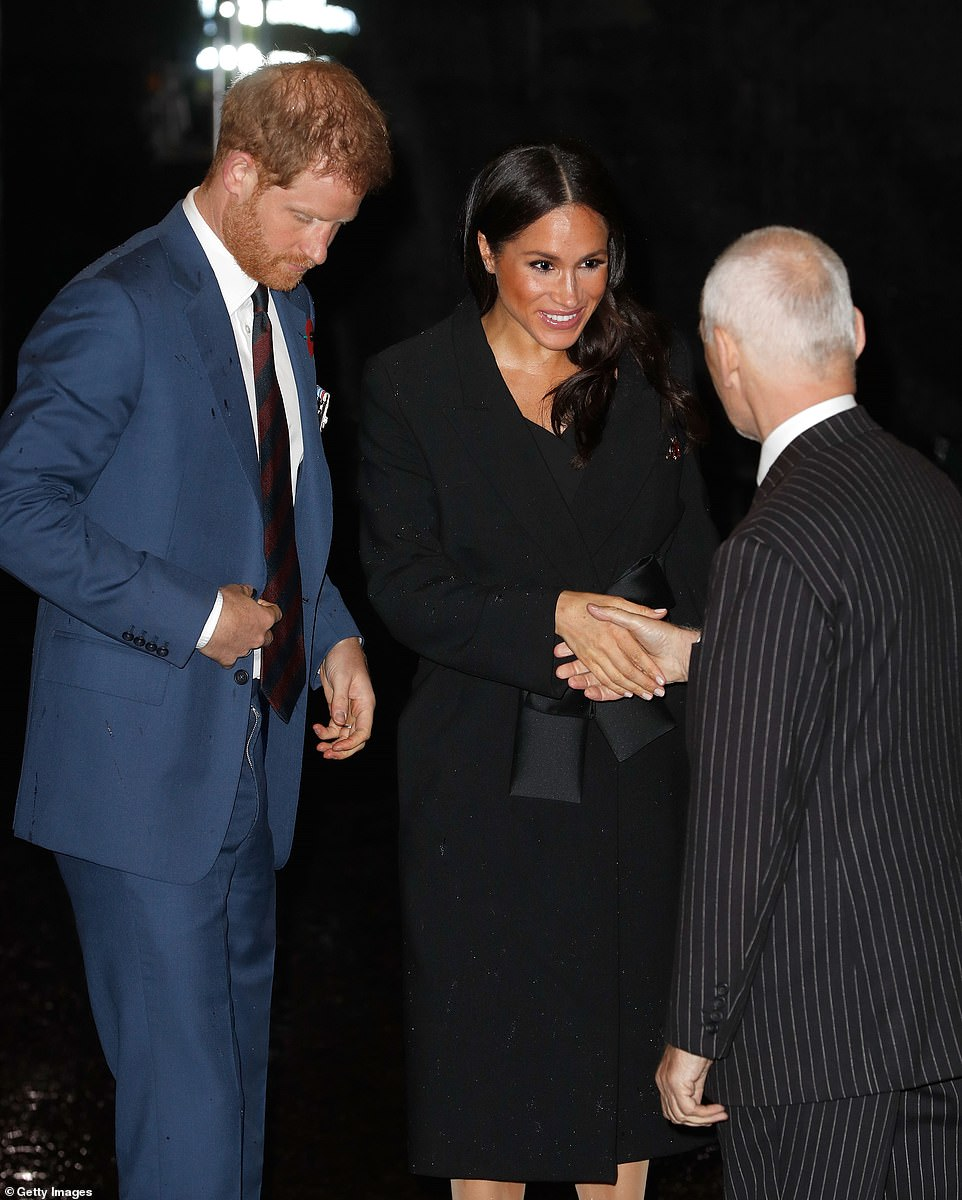 Prince Harry and Duchess of Sussex Meghan Markle greet fellow attendees at tonight's ball ahead of memorial events