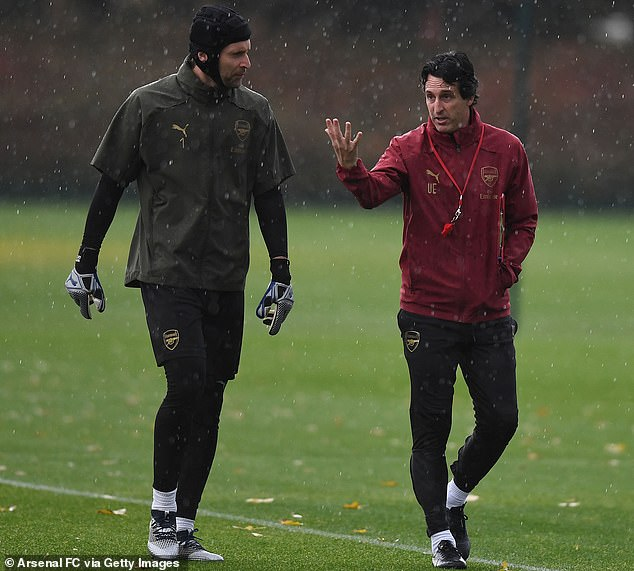 Boss Emery is in conversation with Gunner's keeper Petr Cech, who listens attentively