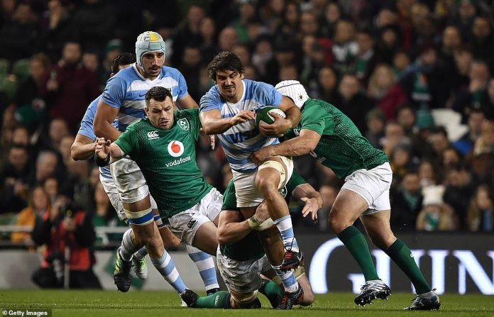 Argentine Pablo Matera is tackled during an intense encounter with Ireland's best Rory Best