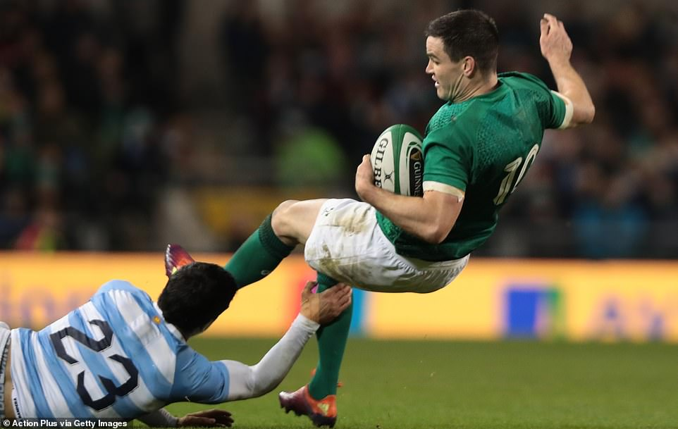 Sexton tries to turn but the Irish player is challenged by Argentina's Matias Moroni