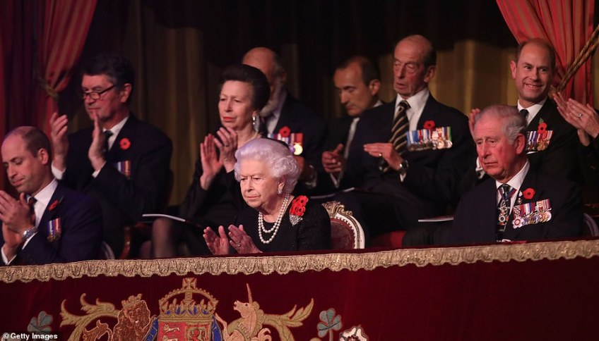 The Queen, Prince William, and Charles, Prince of Wales watch on from the balcony in respect to the show taking place below