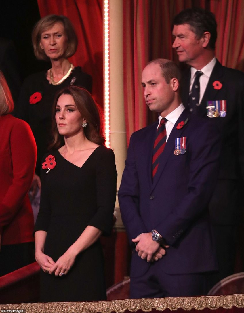 Prince William and the Duchess of Cambridge watch on as a sign of respect to those who sacrificed their lives in Britain's conflicts. The Queen and members of the royal family are attending the show, as well as Theresa May