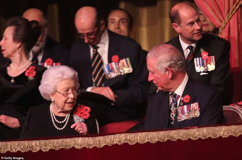 Queen Elizabeth II remarks upon the performance to Charles, Prince of Wales as they enjoy tonight's performances