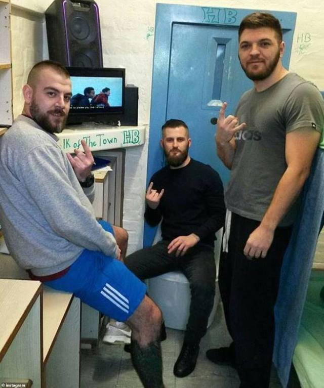 Three men, believed to be gang members of Hellbanizanz, make a gang sign in a prison cell. They claim they are 'ready for war' with rival gangs