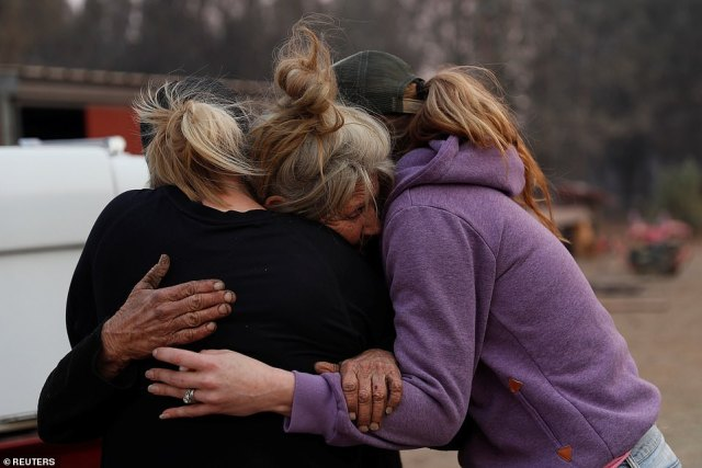 Cathy Fallon (center), who lives in Paradise, stayed behind to tend to her horses during the Camp Fire. She survived, and was pictured embracing Shawna De Long (left) and April Smith who brought supplies for the horses
