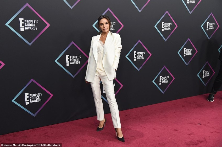 Chic: Victoria Beckham looked incredible in a white suit, which included a lace camisole and pointed heels