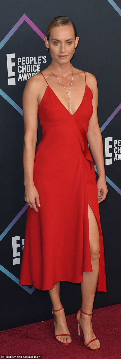 Shades of red:Amber Valletta (L) and Shay Mitchell (R) stood out on the carpet