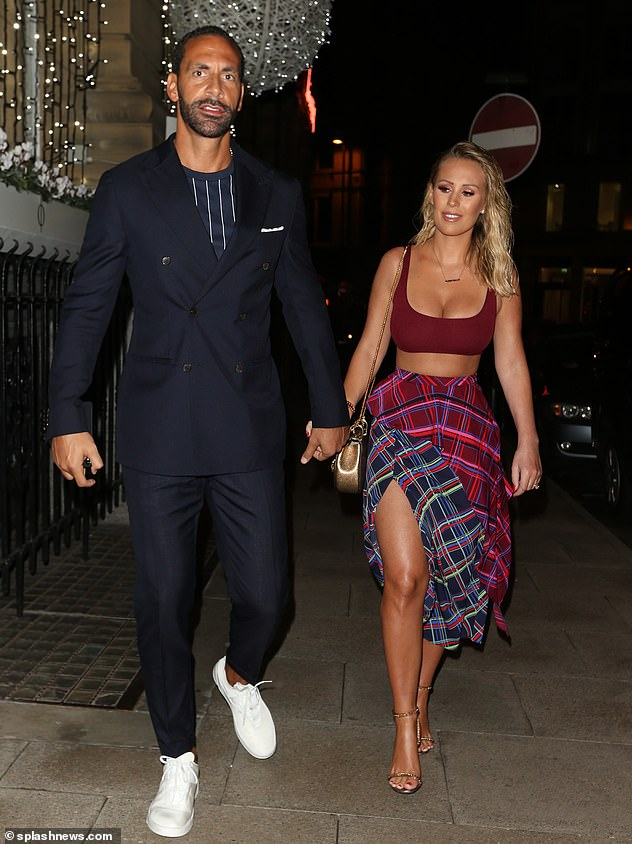 Suave:Meanwhile, Rio, who turned 40 on Wednesday, looked dapper in a sleek black suit, teamed with a white pocketsquare and striped tee