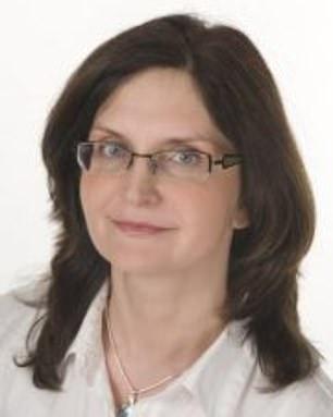 Dr. Joanna Gach, 49, takes a multivitamin capsule containing zinc, selenium and biotin