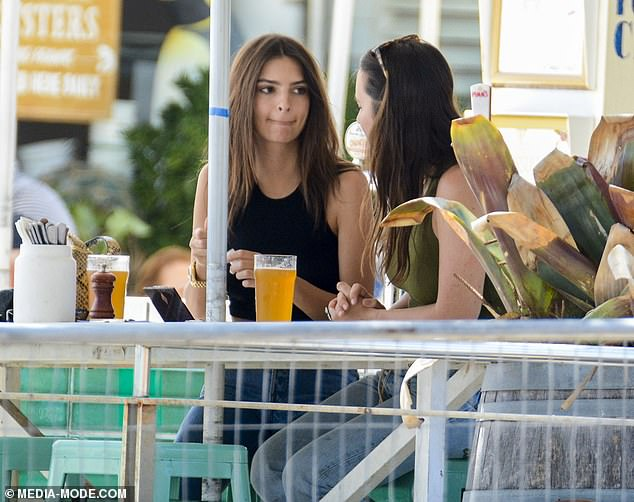 Girl time: Makeup free, Emily was completely at ease as she chatted to her gal pal over the drinks