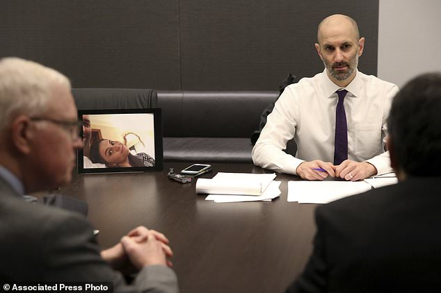 Patrick Wardell, CEO of Cambridge Health Alliance (left), met with Peter DeMarco (right) on Tuesday to apologize for his wife's death outside the company's hospitals (AP)
