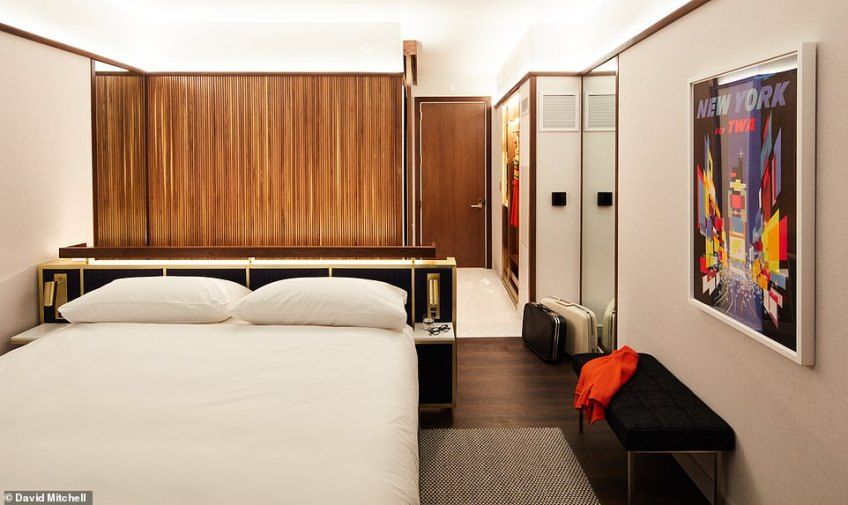 A mock-up hotel room gives a taste of what guests can expect. It shows smart retro-styled fixtures and fittings, with walnut wood panelling adding to the old-school glamour