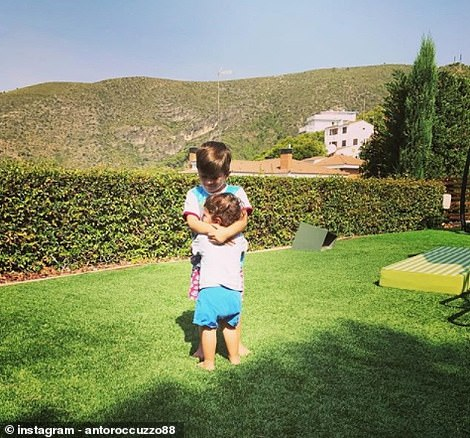 Another view of the garden can be seen in this picture of Thiago and Mateo