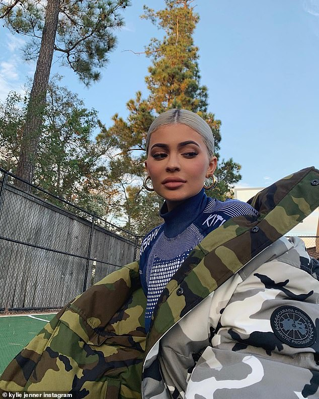 Fancy: In another shot she dressed up the outfit with a reversible Canada Goose camouflage jacket, that featured green colorway on the inside while an arctic pattern covering the outside. The luxe winter jacket retails for about $950