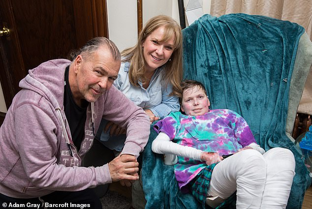 John Hudson Dilgen who has the rare genetic disease Epidermolysis Bullosa (EB) with his parents John and Faye at home in Staten Island, New York