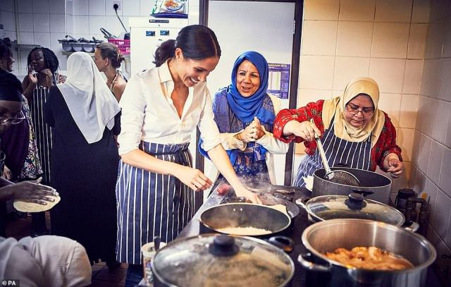 Meghan worked with women from the kitchen on a community cookbook. A publicity photo from its release is pictured