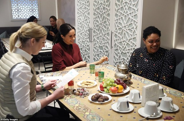 The Duchess of Sussex and her friend, chef Clare Smyth (left), visit the Hubb Community Kitchen this morning