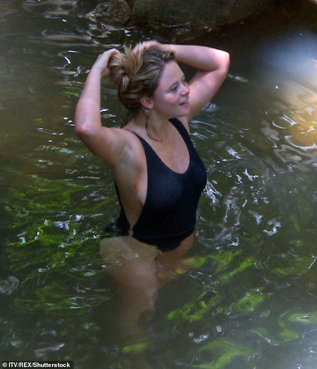 Making a splash: Emily Atack looked sizzling as she enjoyed a dip in the creek in Wednesday's episode of I'm A Celebrity... Get Me Out Of Here!