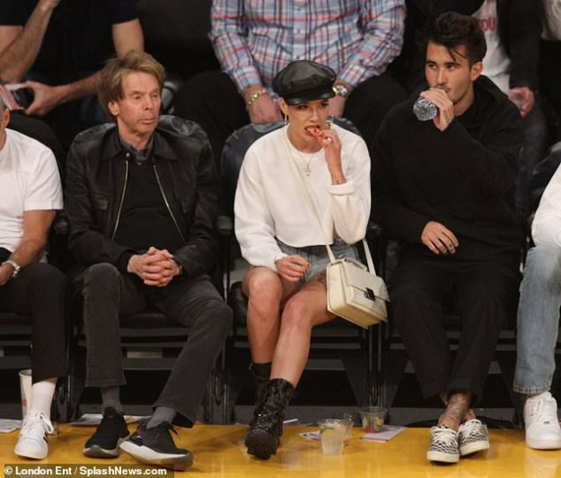 Hungry! The Voice adviser munched away as she indulged on some snacks while she was at the NBA basketball game