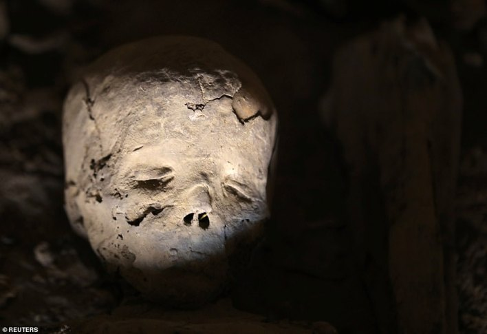 A skull from a child mummy lies inside the newly discovered burial at al-Assassif Necropolis, in Luxor, Egypt November 24, 2018