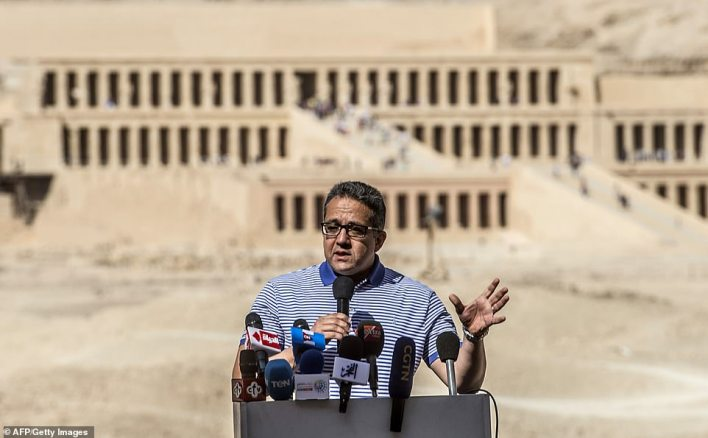 Egypt's Antiquities Minister Khaled El-Enany gives a press conference outside the Temple of Hatshepsut on the west bank of the Nile north of the southern city of Luxor on November 24, 2018, about recent discoveries made at the nearby Al-Assasif necropolis