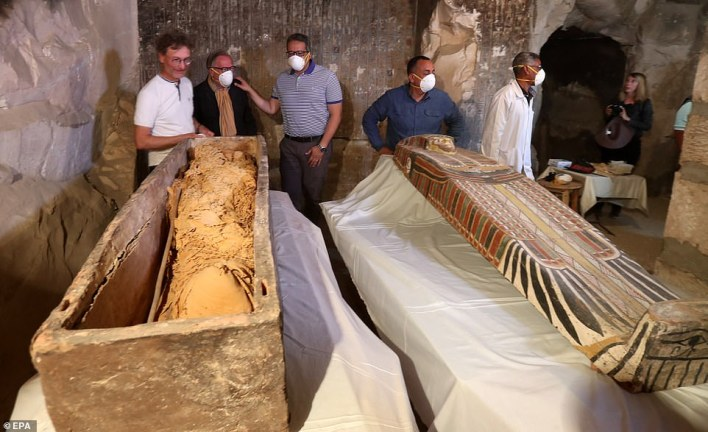 Egyptian Minister of Antiquities Khaled El-Enany (centre), French Professor Frederic Colin (left) head of the French mission, and Mostafa Waziri, Secretary General of the Supreme Council of Antiquities (2R), attend the unveiling of the cover of an intact sarcophagus, inside Tomb TT33 in Luxor