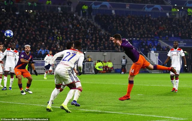 The centre back pictured heading home City's leveller after the ball was flicked on by midfielder Fernandinho