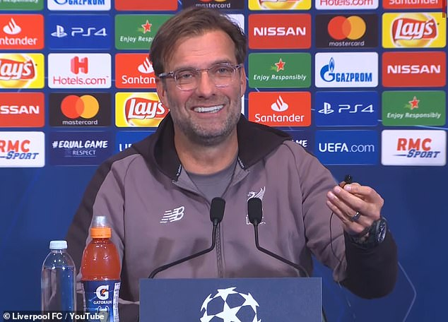 Before answering the question, Klopp removed his earpiece to compliment the voice