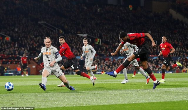 Rashford unleashes a left-foot shot at goal during the first half as Jesse Lingard demands a pass across the penalty area