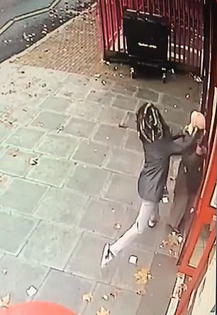 The attacker was caught on CCTV pretending she was in the queue behind her before throwing herself towards the woman and punching her in the head