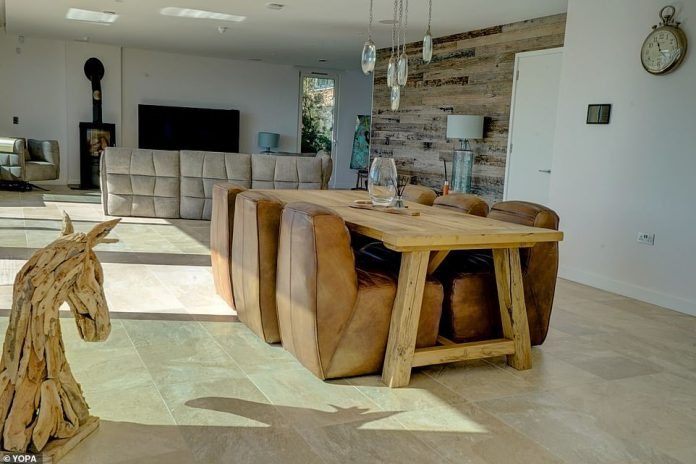 The modern interior has some rustic touches, including in the dining area