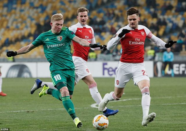 Carl Jenkinson attempts to close down Vorskla's Vladyslav Kulach during the opening period of the encounter