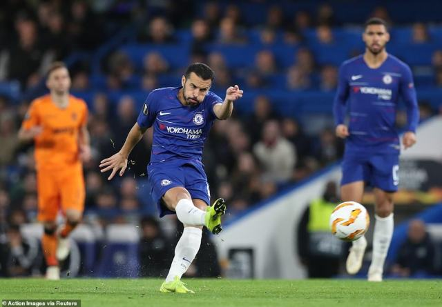 Chelsea forward Pedro lets fly from the edge of the box but sees his effort deflected wide of the goal and out for a corner