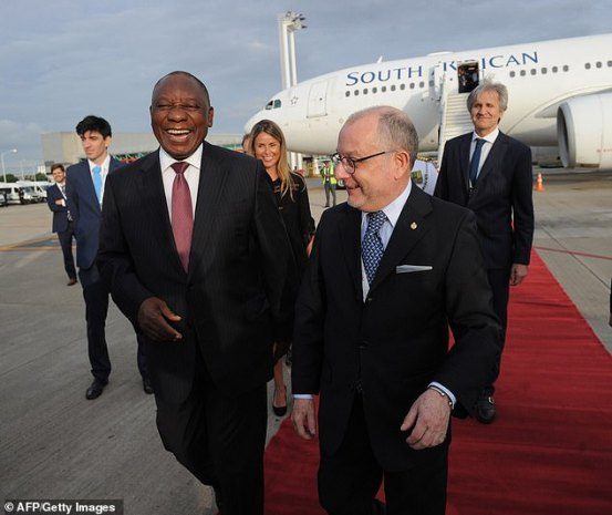 President Cyril Ramaphosa (right) arriving at the G20 summit by Argentina's Foreign Affairs Minister Jorge Faurie, at Ezeiza International airport in Buenos Aires yesterday