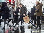 Christmas shoppers braved London's Oxford Street today (pictured), despite the wet weather and strong winds. Brollies and raincoats were on with people determined to make the most of their weekend