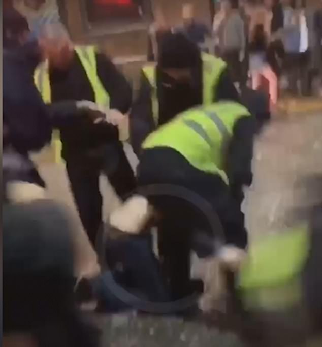 The man then falls to the knees and is punched repeatedly
